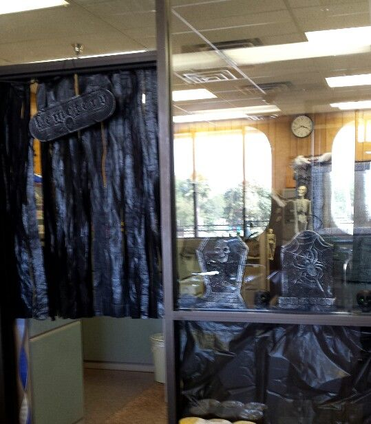office halloween decorations cut up trash bags dollar tree tomb stones and cemetery sign