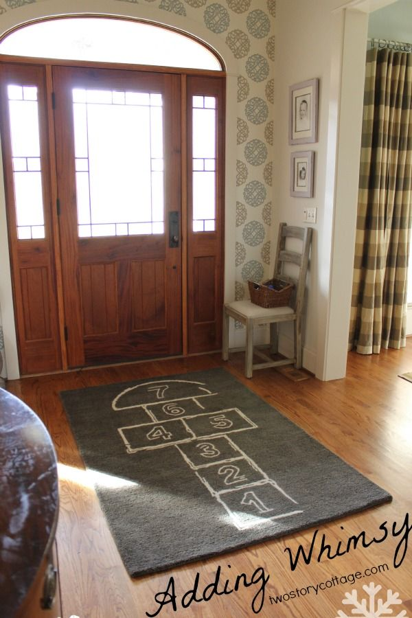 How fun is this? It would be cool painted on the floor facing the other direction. What a way to enter the house. :)