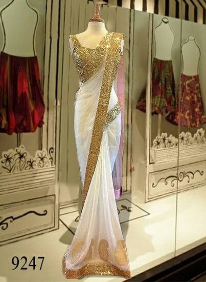 The designer replica saree in White with sequin work. Comes with stitched/unstitched blouse. Perfect to wear in parties and weddings. The fabric is net and blouse is art silk.