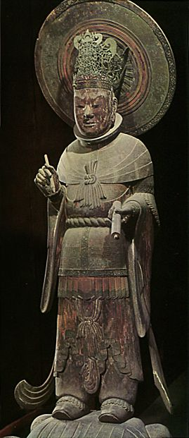 "Wooden standing statue of the Four Heavenly Kings. ""Koumokuten"". The work which Yamaguchi-no-Ooe-no-Atai produced. Asuka era ( 592 – 710 ). Horyu-ji Temple. Nara Japan"