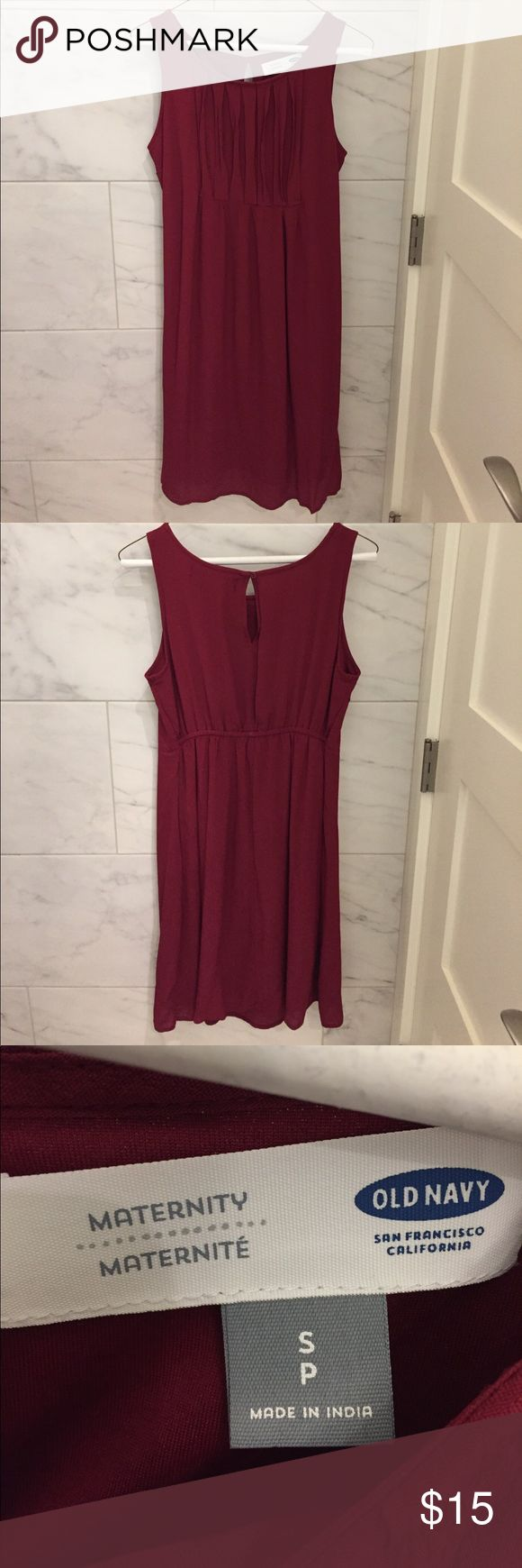 Old Navy maternity dress size small Old Navy maternity dress size small burgundy. Pleats across the front top. Hits above the knee. Worn a handful of times. Great condition. Lined. Old Navy Dresses