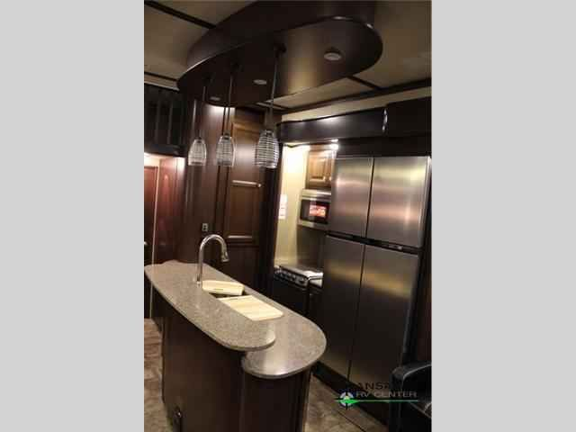 """2016 New Dutchmen Rv Voltage V3895 Toy Hauler in Kansas KS.Recreational Vehicle, rv, 2016 Dutchmen RV Voltage V3895, Our most popular selling Voltage model offers opposed seating, half bath and 12' garage. Loaded as most of our buyers want a high end toy hauler this trailer will be discount priced during our January and February show season. With 12'6"""" of toy parking space, triple slides for added interior space, and one and a half bath, plus loft, this Voltage fifth wheel toy hauler by…"""