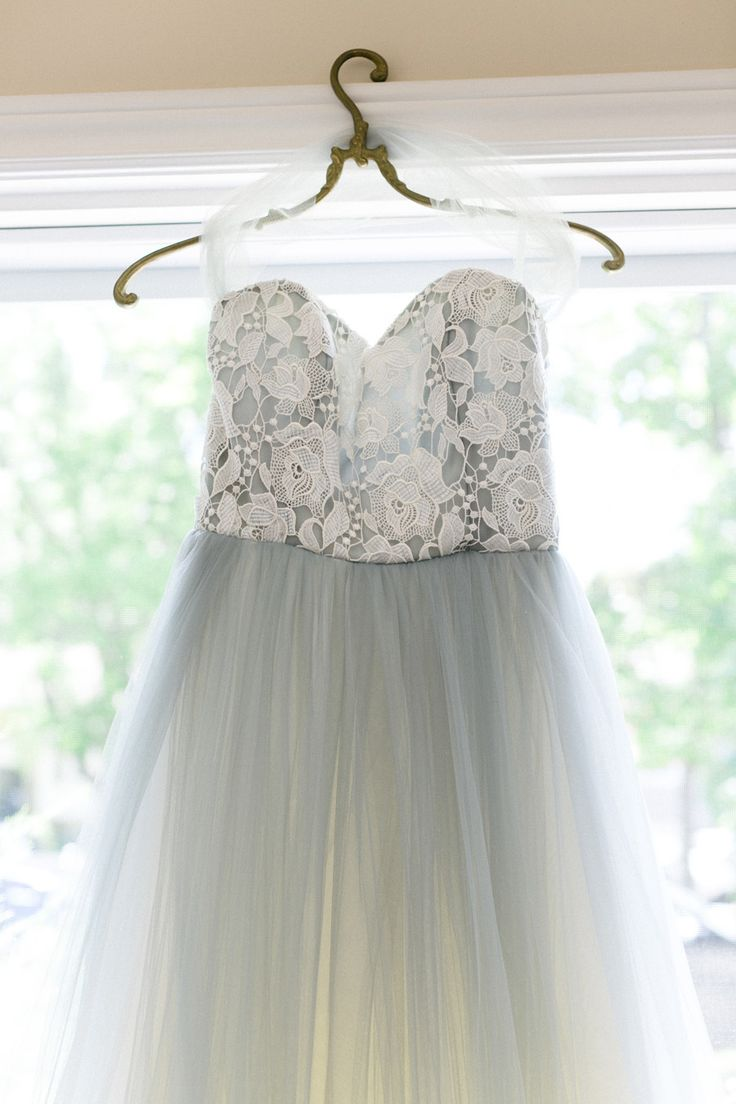 Pretty blue lace wedding dress: Photography : Corina V. Photography Read More on SMP: http://www.stylemepretty.com/canada-weddings/ontario/toronto/2016/04/11/classic-tented-wedding-in-canada/