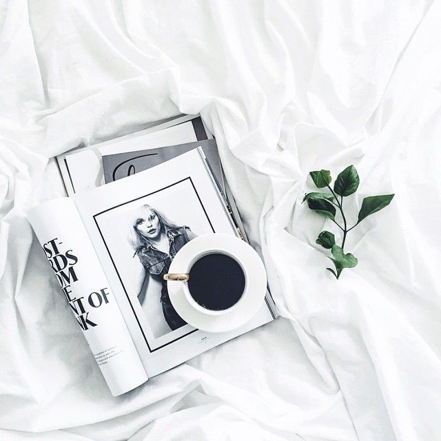 Coffee, magazine, green flat lay.