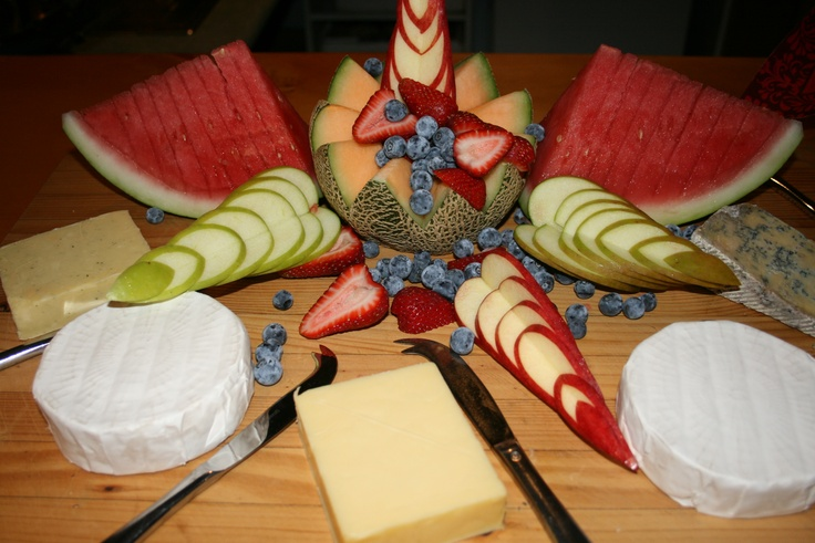 A small cheese and fruit platter.