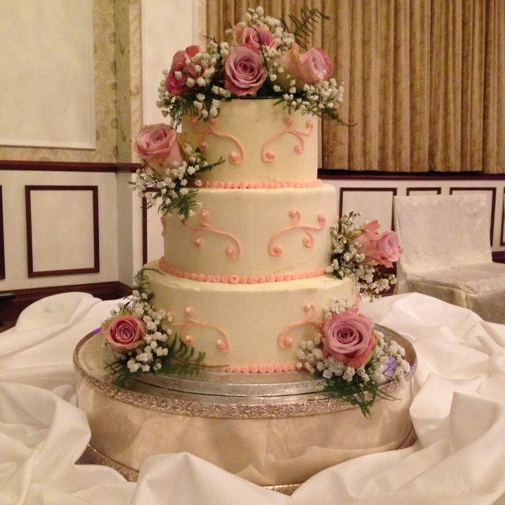 3 tier soft iced wedding cake with pale pink piping details, dressed with fresh flowers. www.kellylou.com