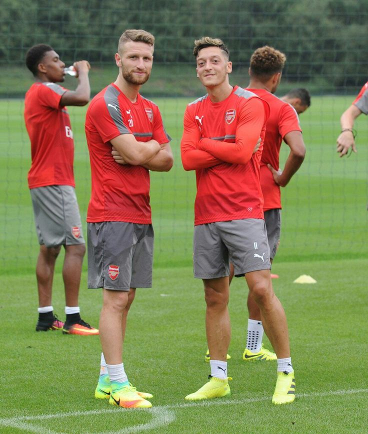 Shkodran Mustafi and Mesut Ozil - Arsenal FC