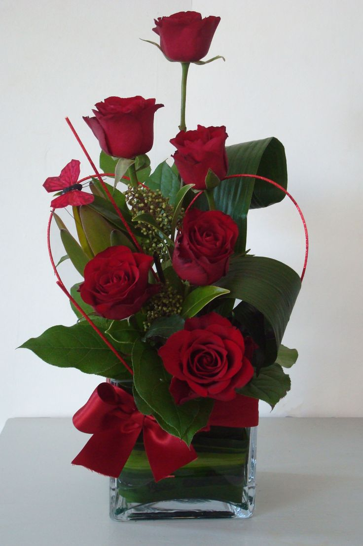Beautiful red roses look close to see the butterfly Floral creations