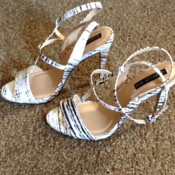 NWOT White & Black Zebra Heels Reach new heights in these gorgeous black and white Izabella Rue heels. These are shoes you will definitely build your outfit around!  Never worn.  Bought from shoe dazzle.  Looks like splatter paint color design almost. Very cute! Shoe Dazzle Shoes Heels
