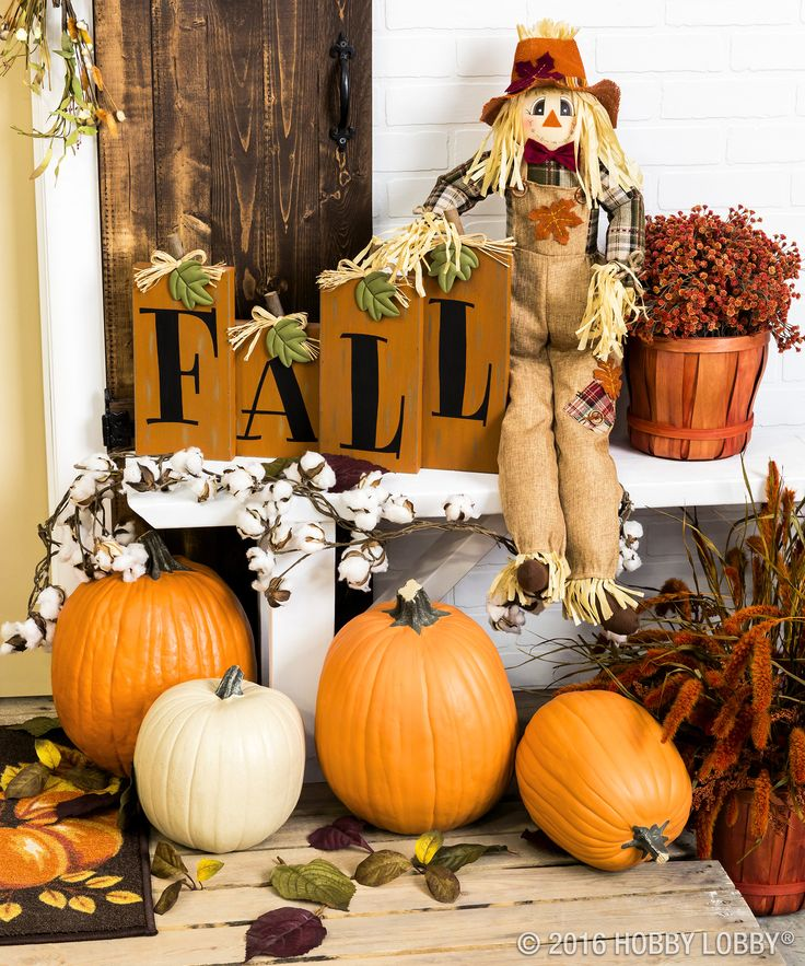Fall in love with your front door decor! Add pumpkins and pops of color for a festive porch.