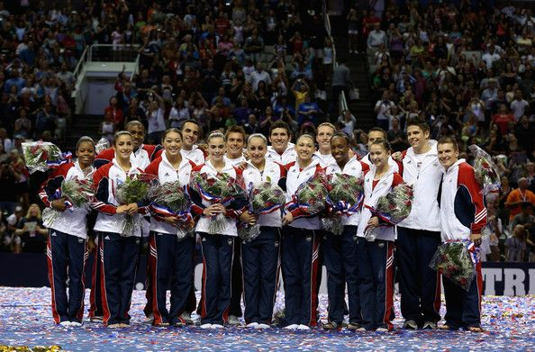 The full 2012 USA Gymnastics Olympic team is formally introduced during the final night of competition at the Olympic Trials.  Back row, from L to R: John Orozco, Danell Leyva, Sam Mikulak, Alex Naddour, Steven Legendre, Jake Dalton, Chris Brooks and Jonathan Horton.  Front row, from L to R: Gabby Douglas, Aly Raisman, Anna Li, McKayla Maroney, Jordyn Wieber, Kyla Ross, Elizabeth Price and Sarah Finnegan.