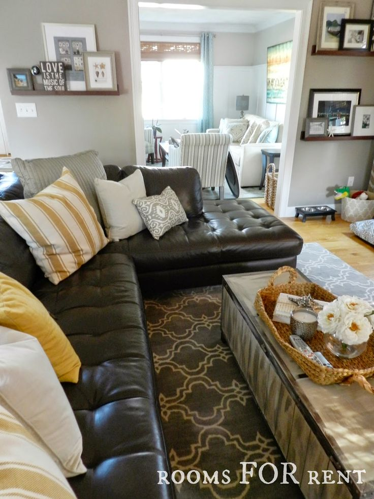 How to Style a Dark Leather Sofa (Den Makeover) use these tips for brown comfy leather couches, key is window treatment, pillows, rug
