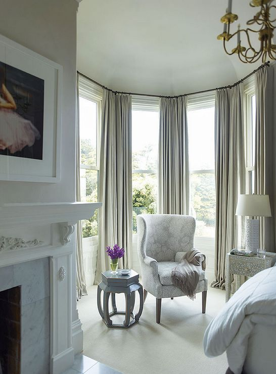 Elegant bedroom features a sitting area fitted with curved windows dressed in grey drapes filled w & 10 best Window dressing Ideas for bay windows images on Pinterest ...