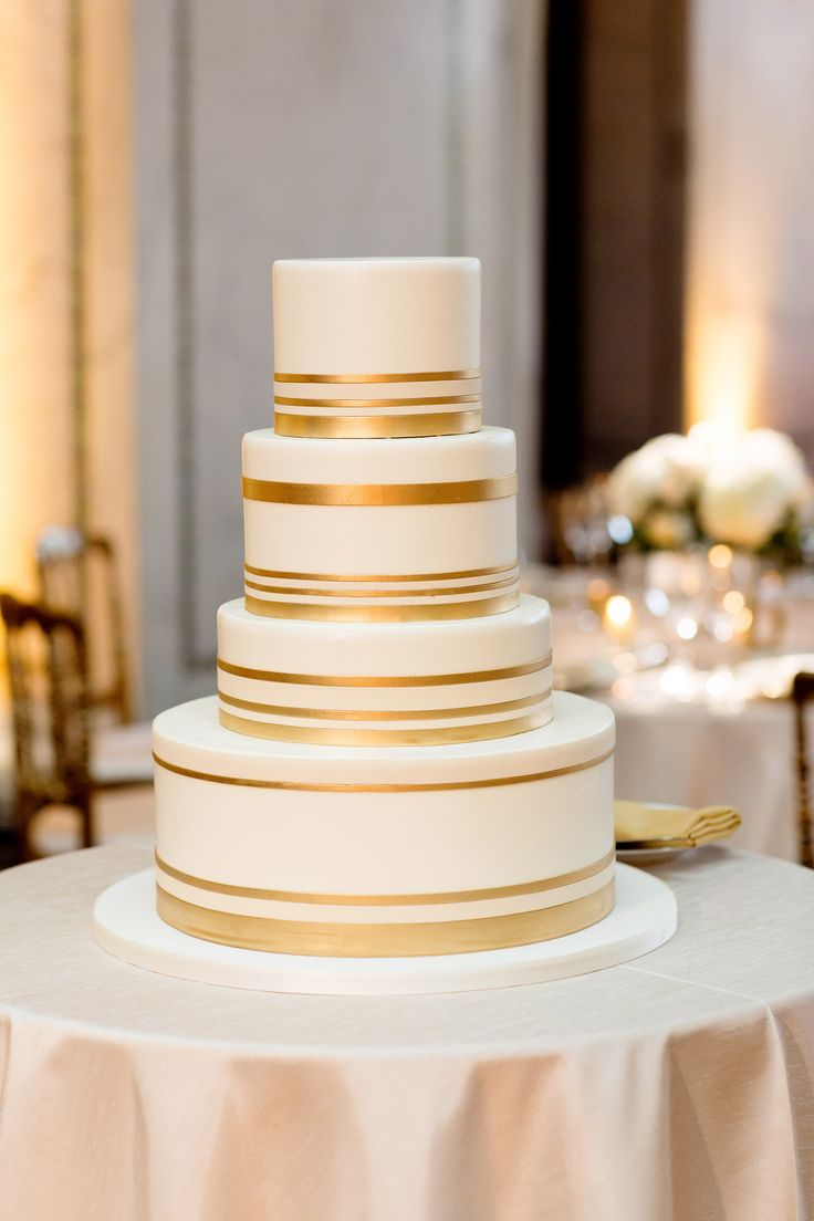 Wedding Cake with Gold Bands | photography by http://olivialeighweddings.com/