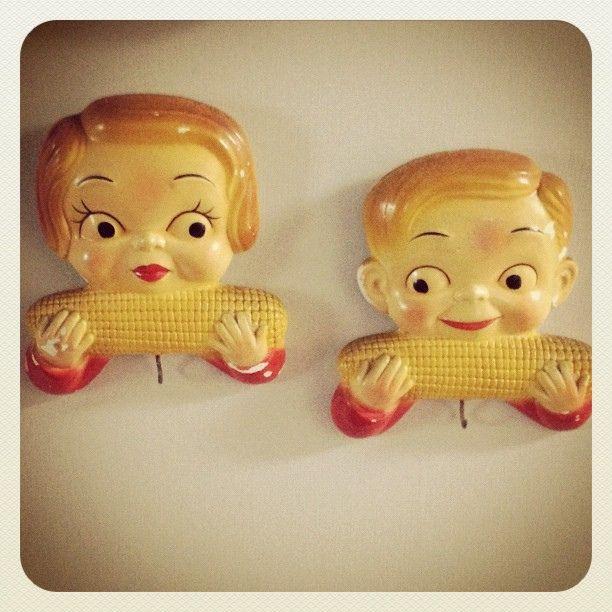 Vintage potholder hooks  ... kids eating corn on the cob. by Pamela Greer, via Flickr