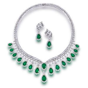 An emerald and diamond necklace and pendant earrings Sold for US$ 170,500 inc. premium