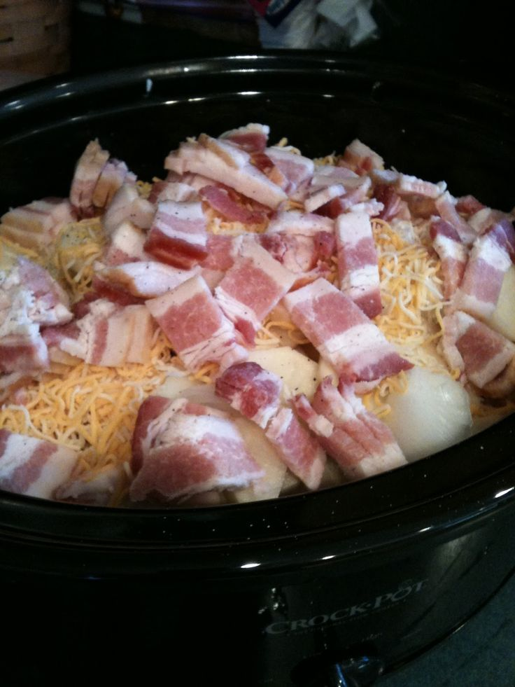 10 pounds potatoes, peeled and sliced 1 large onion, diced 16 slices thick cut bacon, uncooked and diced 4 cups shredded taco blend cheese 1 28 oz can cream of chicken soup ~Place half of the sliced potatoes in the bottom of crock. ~Top with half of onion, cheese and bacon. ~Repeat layers. ~Top with cream of chicken soup. ~Cook on low of 8 to 10 hours. Easy peezy!!!!.
