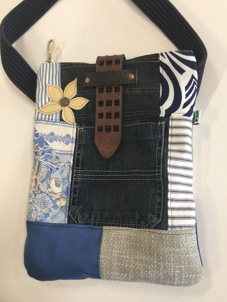 A personal favorite from my Etsy shop https://www.etsy.com/listing/547534013/tablet-sized-sling-bag-denimnavy