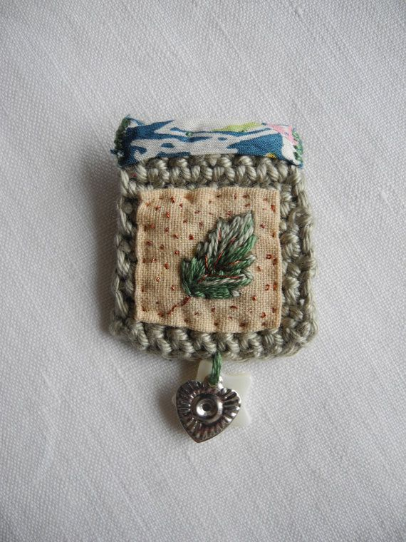 mixed media (mostly embroidery and crochet) little brooch - lovely detail - talented lady!! giovabrusa @ Etsy