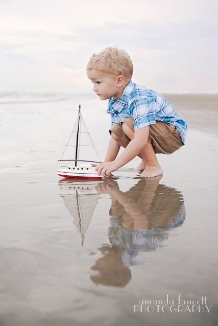 Charming shot of a boy, the water, and his sailboat. Photo by amanda faucett from the series All Boy