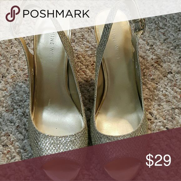 "Nine West Gold Silver Sparkly Heels Size 6.5 Looking for a perfect pair of heels that just go with any of your party dresses? These Nine West heels will do. Minimal sign of wear. These gold silver open-toe heels will make a really nice addition to your shoes collection.   ℹ 3.5"" heel ℹ a mix of gold and silver colors ℹ US women's size 6.5 with adjustable ankle straps ℹ Comfy heels with lots of life left in them  ✅Open to offers✅ Nine West Shoes Heels"