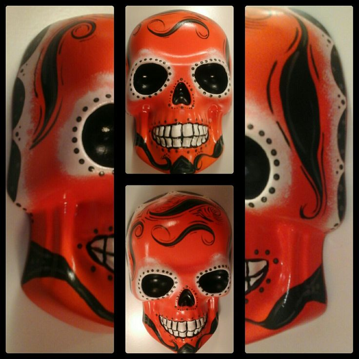 Wall hanging skull orange with dark green.. Made from plaster of paris..Painted with acrylic paint. Las Calaveras And Things..