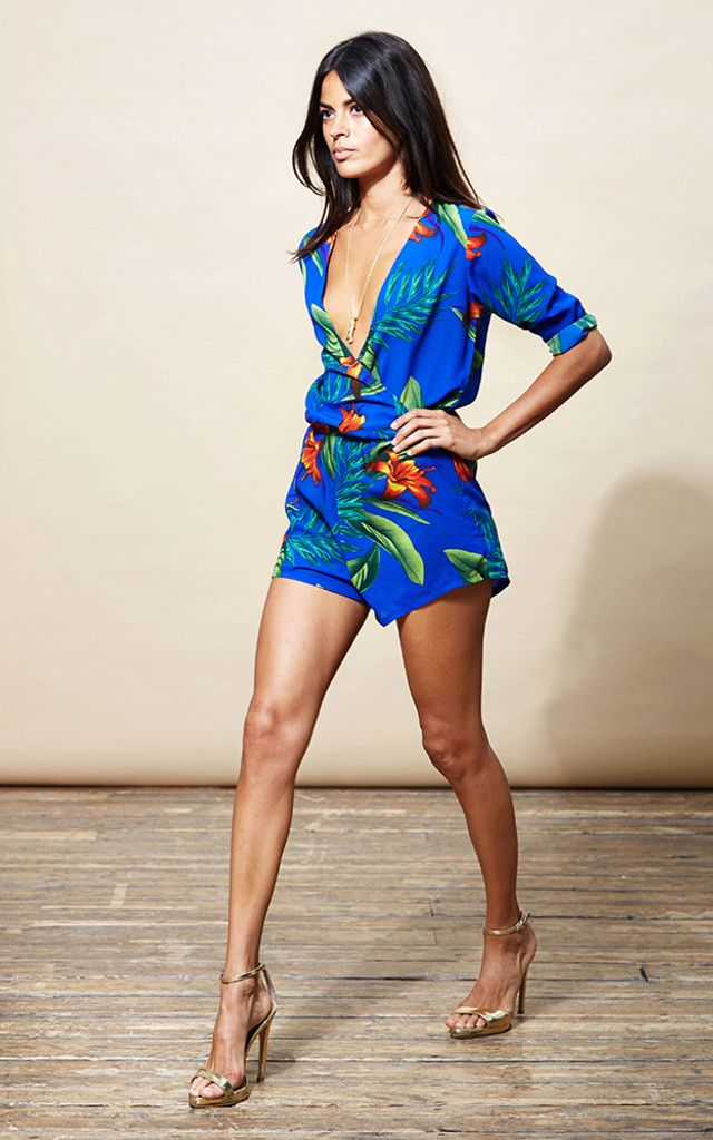 Slim fitting blue tropical print playsuit with cross-over front and 3/4 sleeves. Shop now