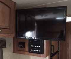 """2014 Used Forest River Flagstaff Micro Lite 23LB Travel Trailer in Florida FL.Recreational Vehicle, rv, 2014 Forest River Flagstaff Micro Lite 23LB, 23 ft, easy to tow, 2014 Micro Lite travel trailer, Only 3759 pounds, excellent condition, Queen Murphy bed, bunkhouse, power awning, power tongue jack, upgraded convenience package includes, 24"""" mounted LCD tv with am/fm stereo, DVD player, inside/outside speakers, outside TV mount, outside shower, microwave, water filter, and outside BBQ…"""