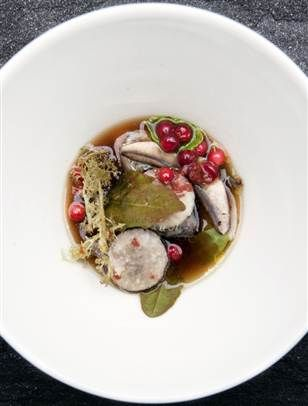 "A smoked fish soup with beetroots, mushrooms, woodsorrel, berries, brown butter, broth of mushrooms and raw lichen, prepared by chefs Inaki Aizpitarte and Petter Nilsson during ""Cook It Raw,"" in Lapland, Finland."