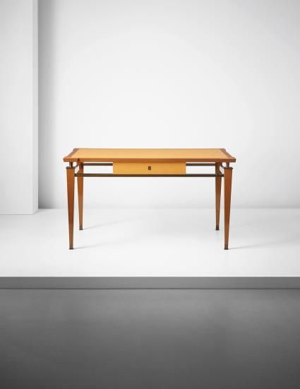 Jacques Quinet, 1955-1957 Brass, mahogany, leather.