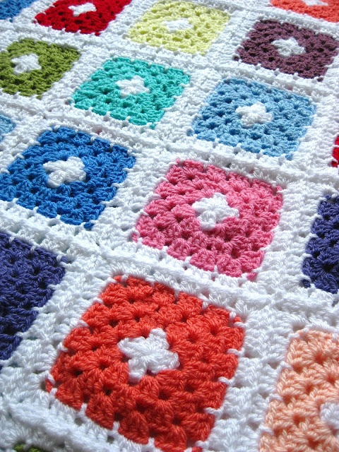 This blanket is so pretty.  Plus she shows how to add a chain round to the granny squares.