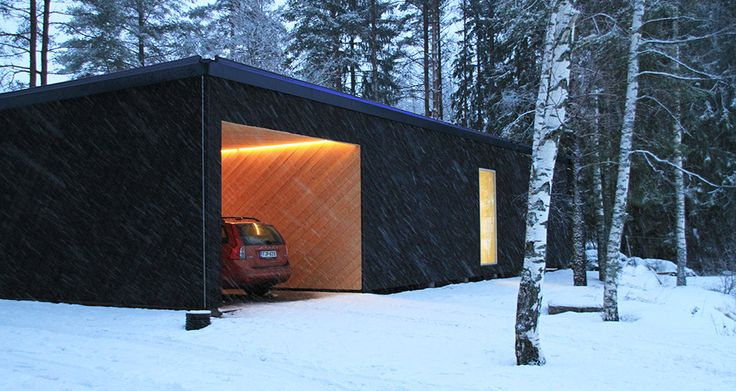 First built Atelier House in the winter. View of the garage.
