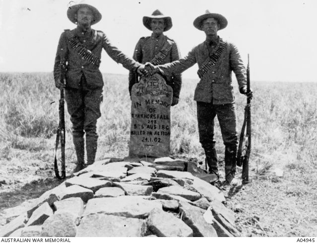 Three Australians stand over the grave of their comrade Trooper Nathaniel Horsfall of the 5th South Australian Imperial Bushmen who was mortally wounded during the Boer War near Lindley on ...