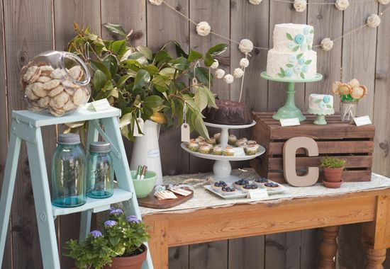 charming dessert table: vanilla and fresh strawberry cake, triple chocolate bundt cake, mini lemon meringue cupcakes, blueberry tarts, key lime coconut cookies and cherry pie pops.