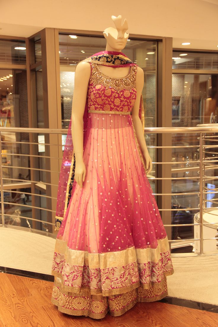 Elegant Light Pink Lacha dress in micro net  with crystal chaan on the shirt, exotic gold embroidery on the blouse finished with light gold and hot pink wide banarsi border and matching duppatta.