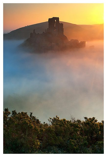 Corfe Castle sunrise in mist, Dorset, England
