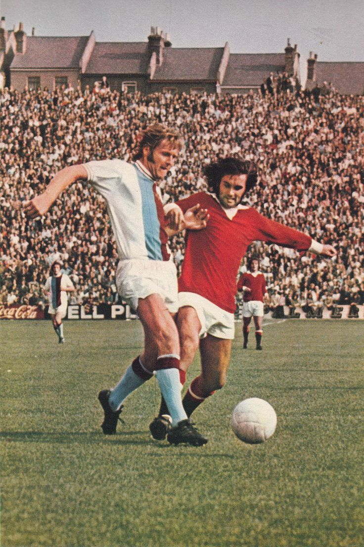 17th April 1971. Crystal Palace centre half John McCormack caught in possession by Manchester United winger George Best.