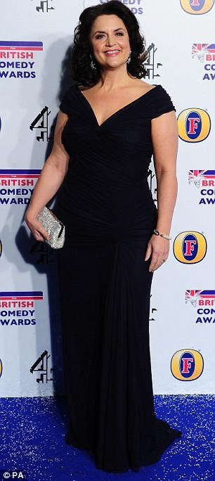 Ruth Jones glams up her outfit with a sparkly clutch bag.