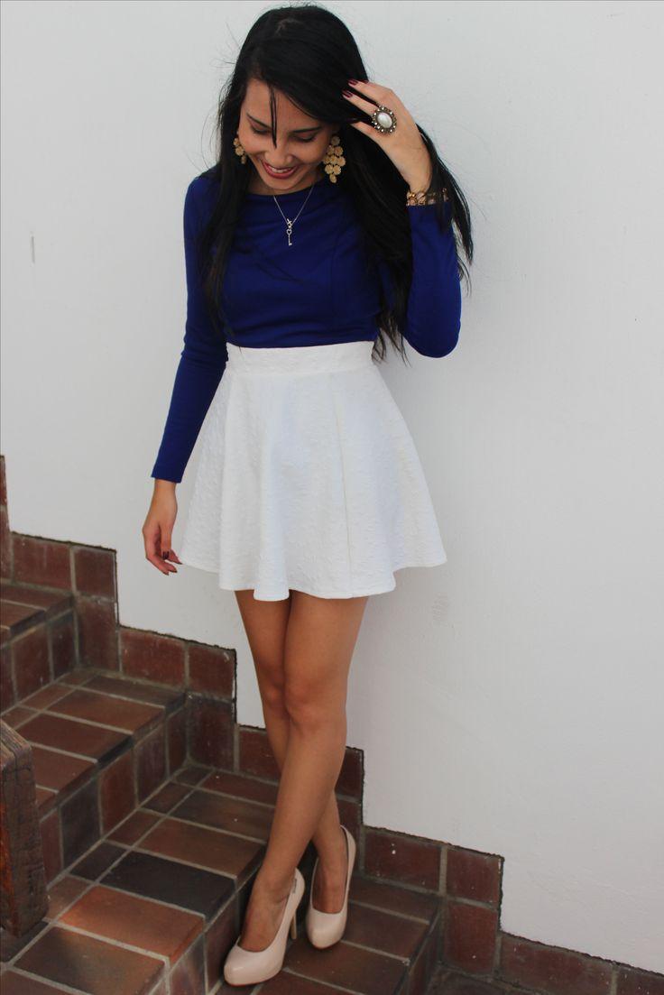 royal blue top white skirt nude high heels