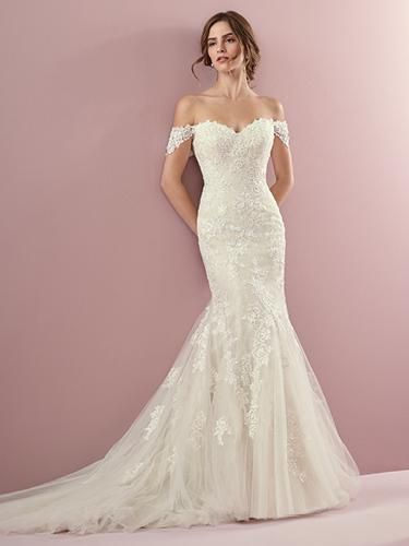 Classic lace motifs cascade over this tulle fit-and-flare wedding dress, trimmin…