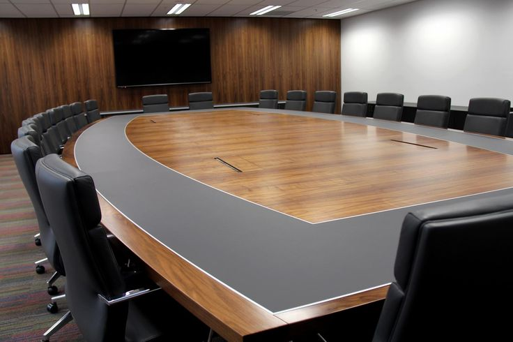 Custom made boardroom table with leather inlays, executive boadroom chair