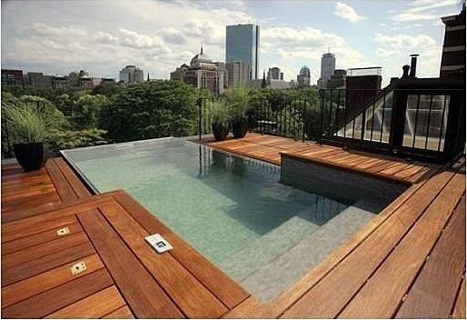 "On top of a classic limestone fronted townhouse at 74 Beacon Street (""The Benjamin Mansion"") right here in Beacon Hill in Boston is kind of the last place you'd imagine an infinity pool, but this set-up is not too shabby. That swanky rooftop view does not come cheap, alas, as this 8400+ square foot, totally renovated, historic home overlooking the Public Garden will cost you $14.9 mil."
