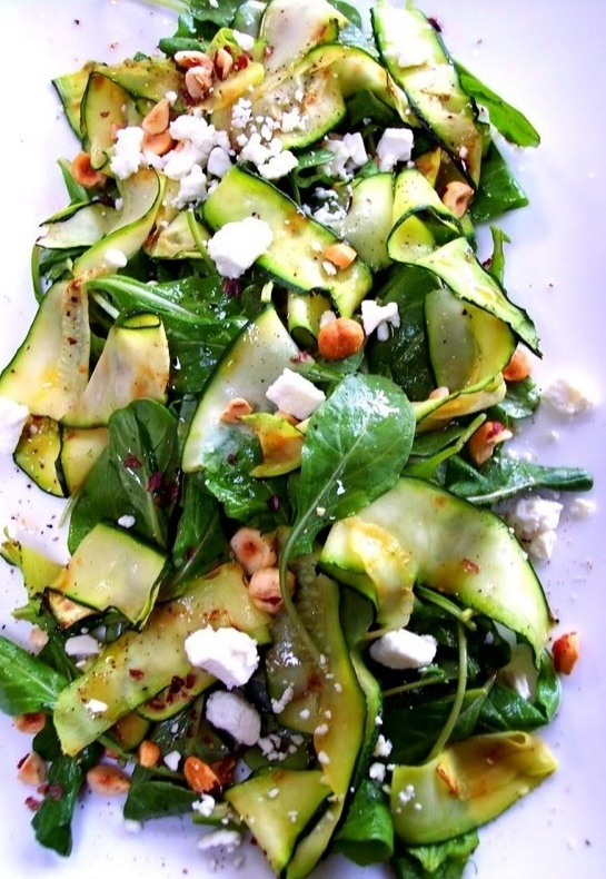 photo inspiration: zucchini thin-sliced into ovals on the diagonal with the peeler, with sliced kale, olive oil, lemon, salt, and pepper, chopped toasted hazelnuts, mint, feta, spinach and baby lettuces, tossed with more dressing
