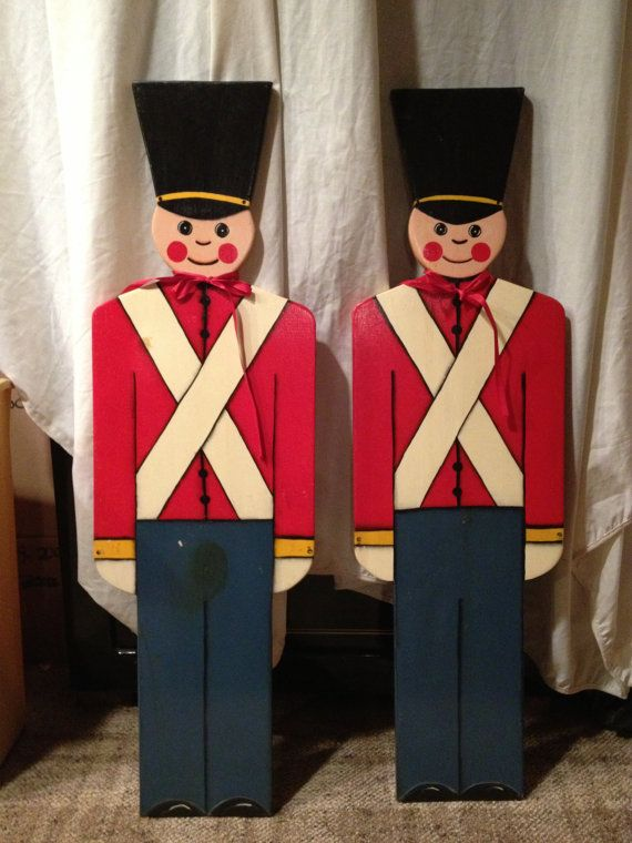 Up for sale are TWO Hand Painted Wooden Toy Soldier Plaques - 37 high and 3/4 wide . Vintage but not antique. Look to be from the 70s but could