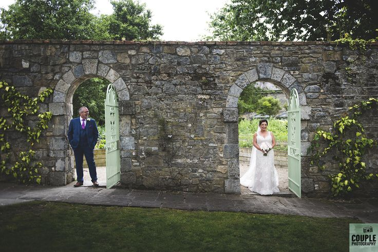 In the doorway at Cliff at Lyons. Wedding by Couple Photography https://www.couple.ie