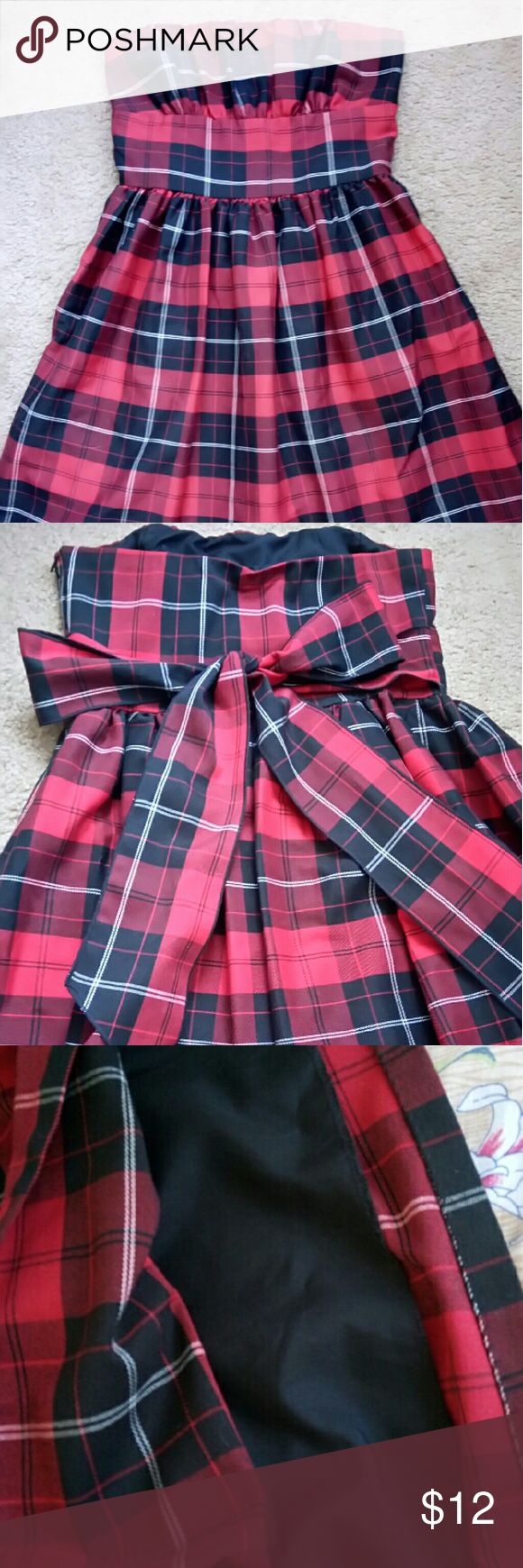 Scottish tartan strapless dress Re-poshing this lovely holiday dress because it was too snug on me.would better fit someone small with bra cup size b. Has a lovely bow at the back that can be tied to it fit better on your curves.  Has a side hidden zipper. Perfect for new years or any winter day. Ask for measurement or any other questions. Necessary Objects Dresses Midi