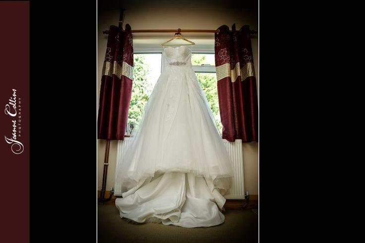 Chilham Castle Estate Wedding Photographer brides dress window