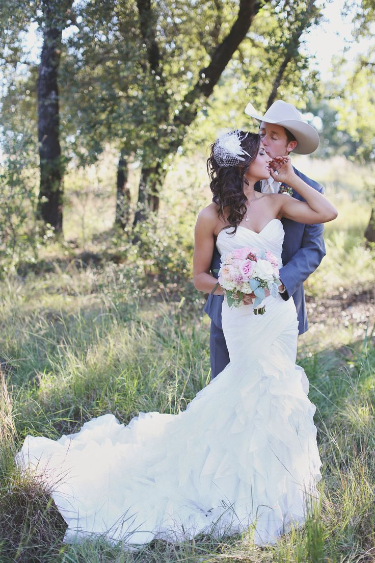 A rodeo star and songstress tie the knot, cowboy-style.