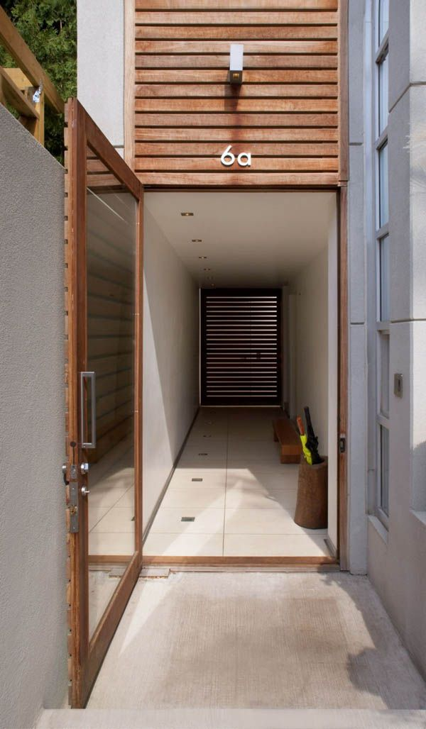 Minimalist House Oversized Door And Modern Entryway At The Brockton By Cecconi Simone