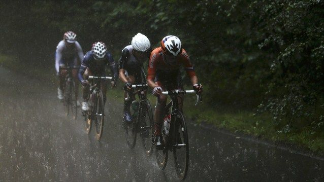 Marianne Vos of Netherlands, Elizabeth Armitstead of Great Britain, Kristin Armstrong of the United States and Olga Zabelinskaya of Russia cycle in the rain during the Women's Road Race Road Cycling on Day 2.